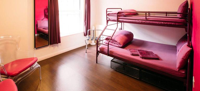 A pink hostel room