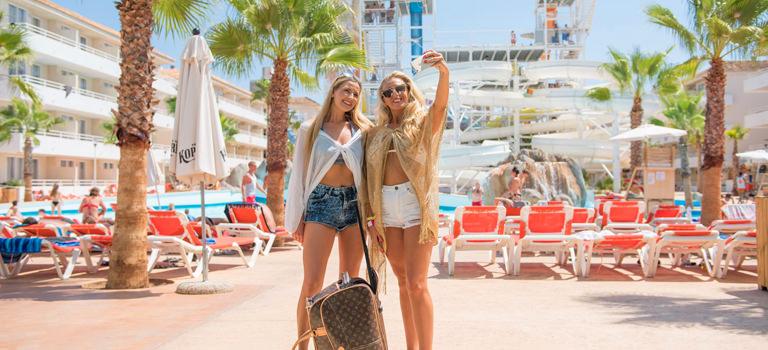 Two women taking a selfie outside a hotel