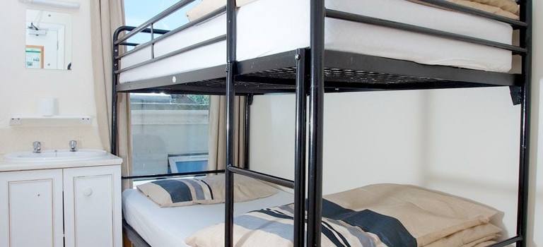 Bunk beds with a sea view perfect for a hen party weekend at The Escape Surf Lodge Newquay
