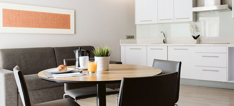 An apartment layout with a white kitchen