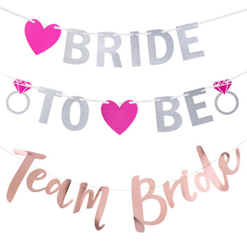 A silver and pink bride to be banner and a rose gold team bride banner.