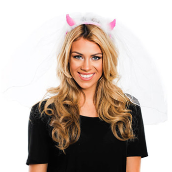 A model wearing a pair of pink devil horns with a white veil