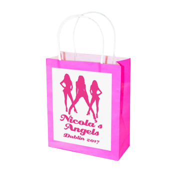 A pink gift bag with a personalised label on the front.