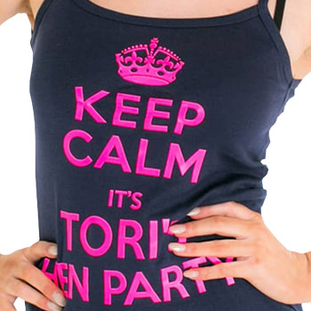 A black vest top with hot pink text on it.