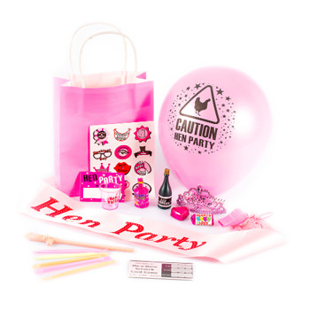 A gift bag with a balloon, stickers, straws, shot glasses and other assorted items.