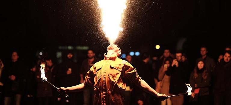 A man breathing fire