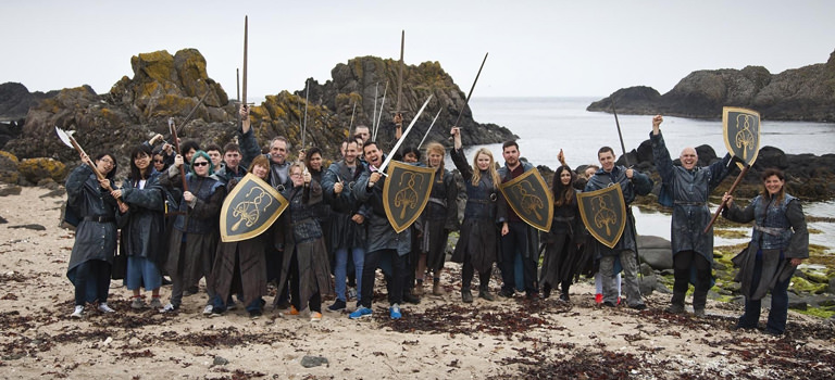 A group of people dressed as Game of Thrones characters on a beach
