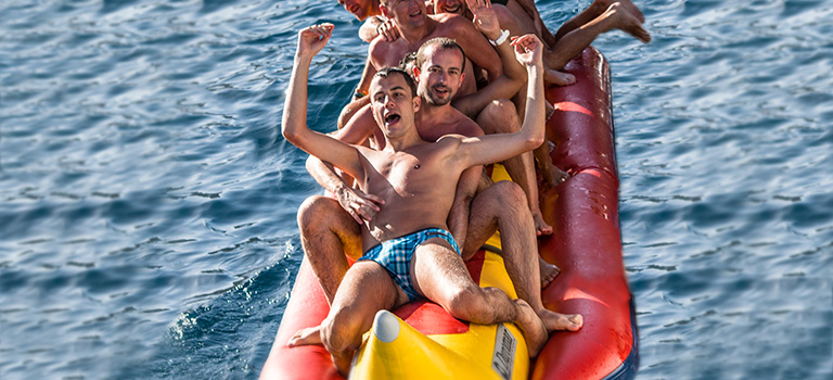 Some men on a banana boat in Benidorm