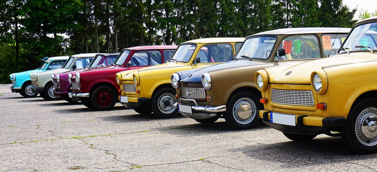 Some Minis lined up in a car park