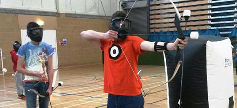 A man using a bow and arrow