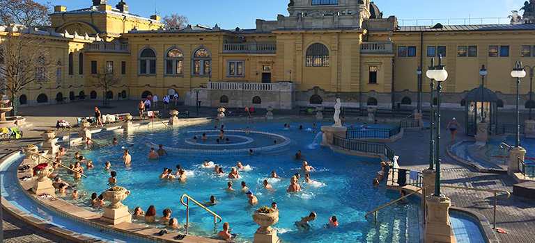 Lots of people swimming in the Szechenyi Thermal Baths in Budapest