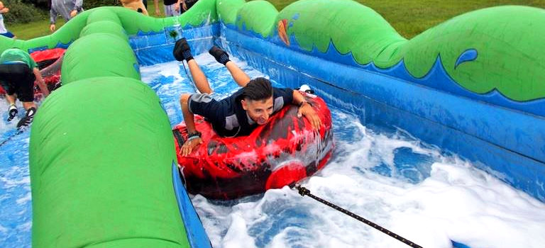 A man taking part in an inflatable obstacle course