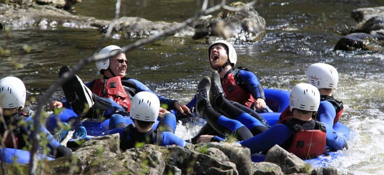 A group of stags white water rafting