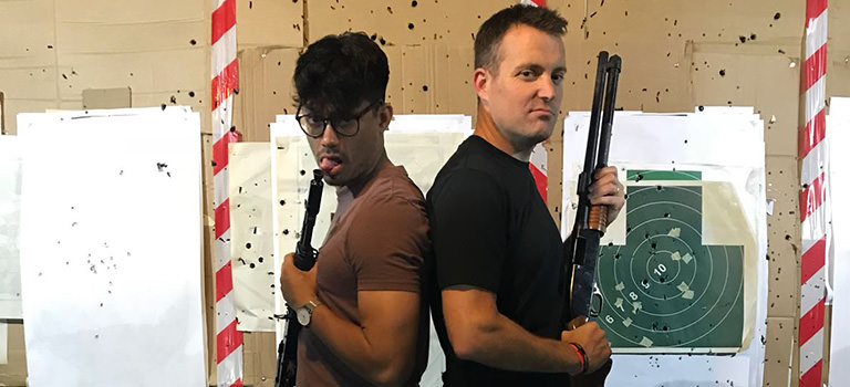 Two men holding guns