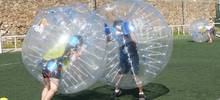 Two people in zorbs