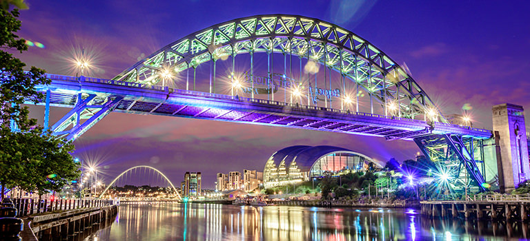 Newcastle's iconic Tyne Bridge, illuminated at night