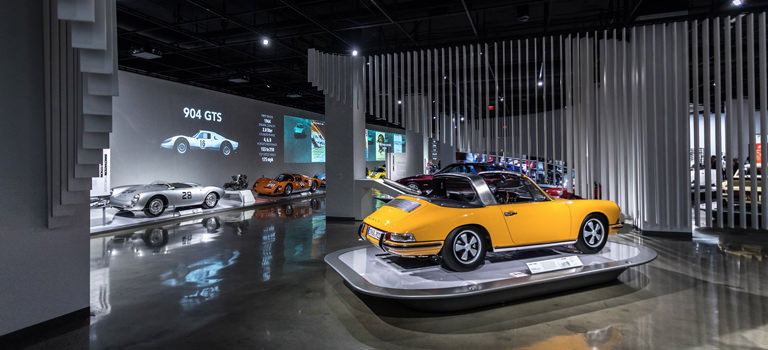 Several cars inside the Porsche Museum