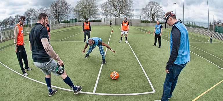 A group of men playing goggle football