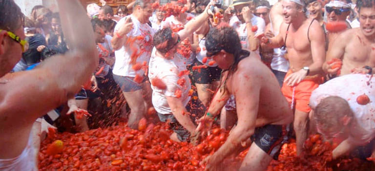 A group of men at a tomato festival
