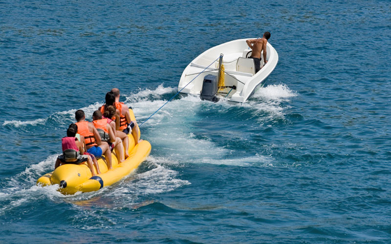 Some people on a banana boat in the Algarve