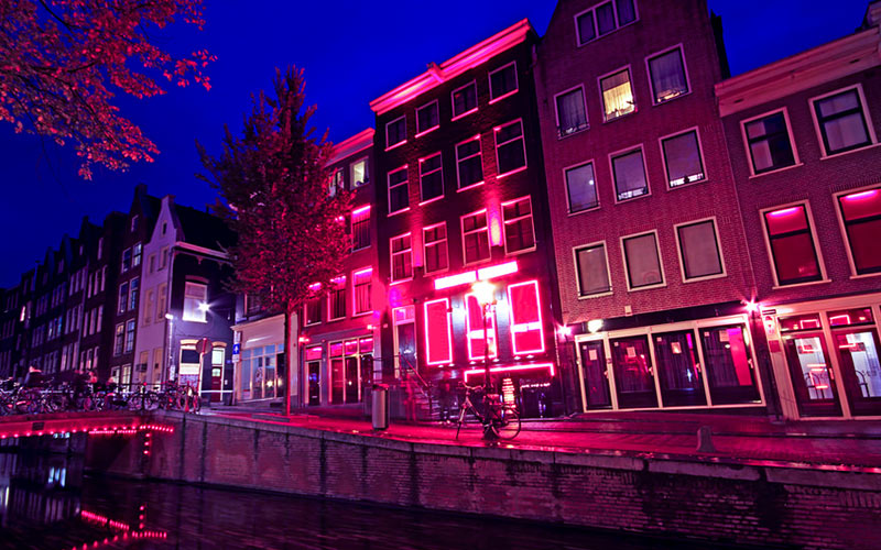 Some buildings in Amsterdam illuminated by a pink light