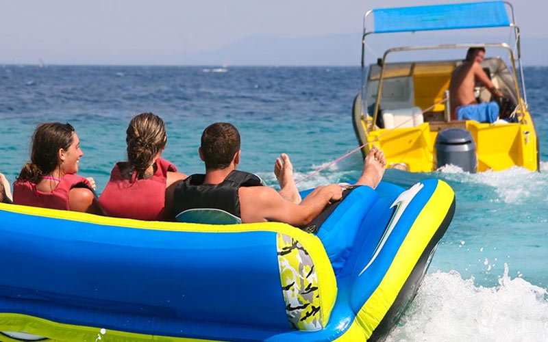 Three people on a banana boat in Barcelona