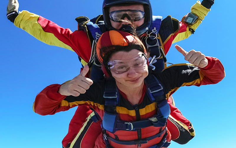 A girl skydiving with an instructor
