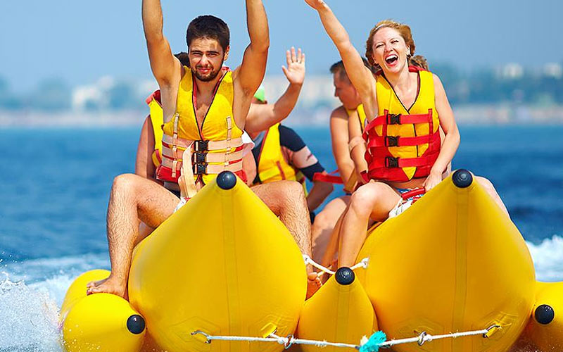 A group of people on a banana boat