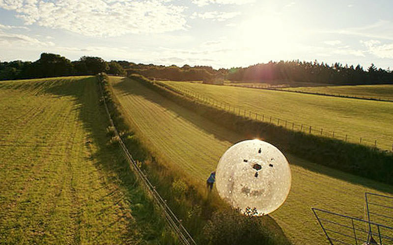 Someone in a zorb on a stag do in Belfast