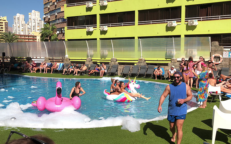 Some people at a pool party in Benidorm