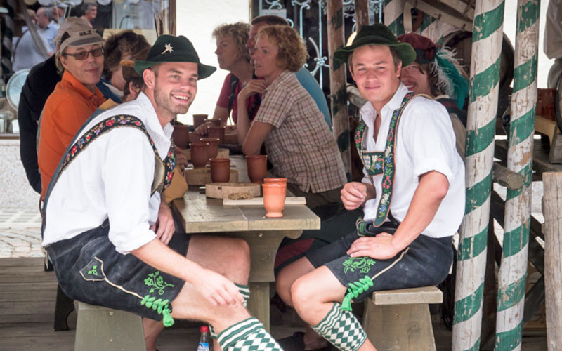 Two men wearing lederhosen and Bavarian clothing
