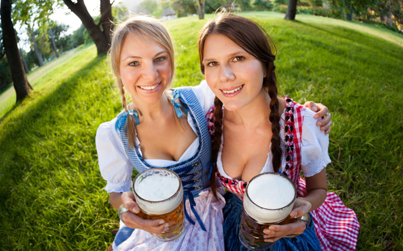 Two women in Bavarian beer maid outfits