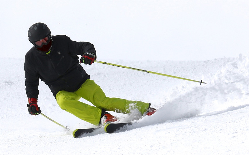 A man skiing on the slopes