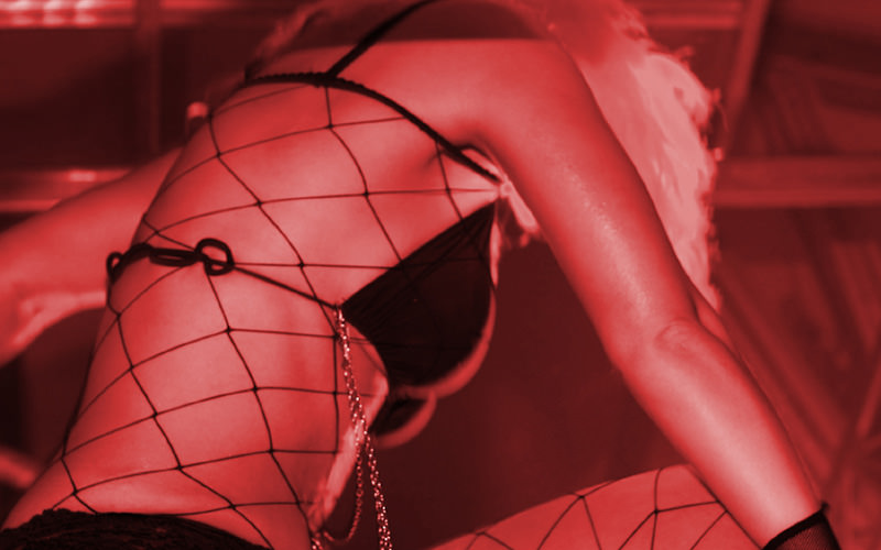 A stripper wearing a fish net bikini
