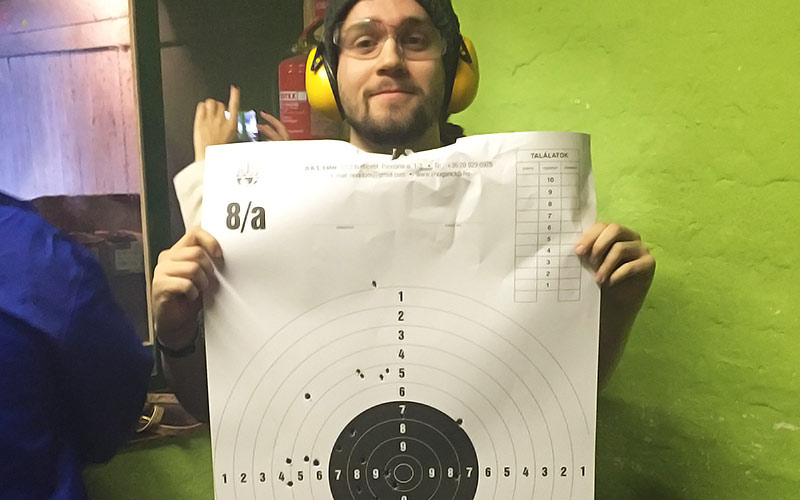 An LNOF member of staff holding up a target for shooting