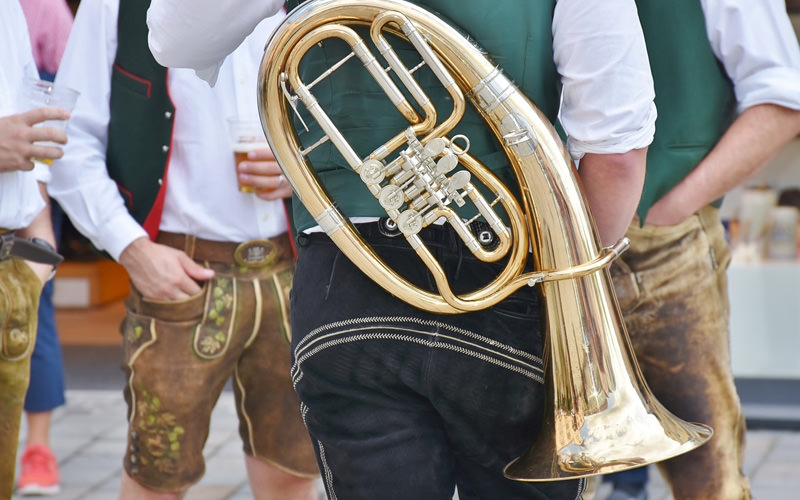 A German band carrying brass instruments
