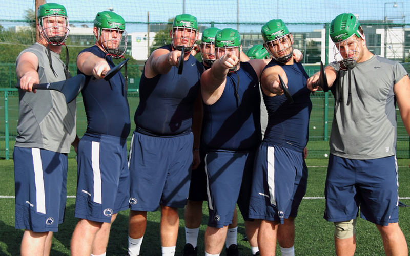 Some lads in helmets on astroturf