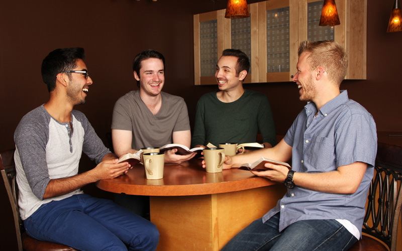 Four men sitting in a pub around a table