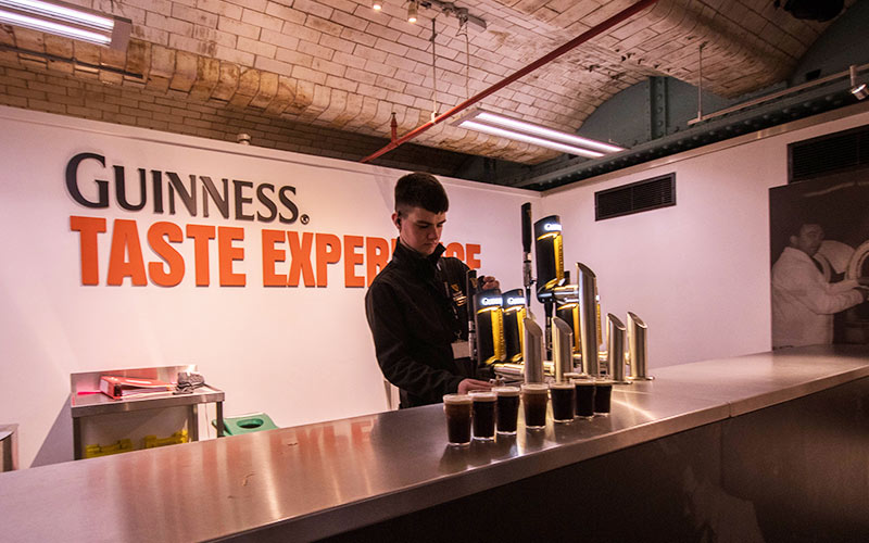 A man behind the bar in the Guinness Factory