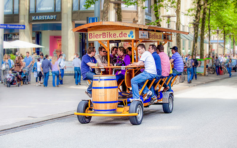 Some stags on a beer bike in the centre of the city