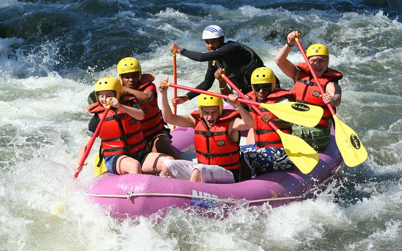 A boat full of men paddling