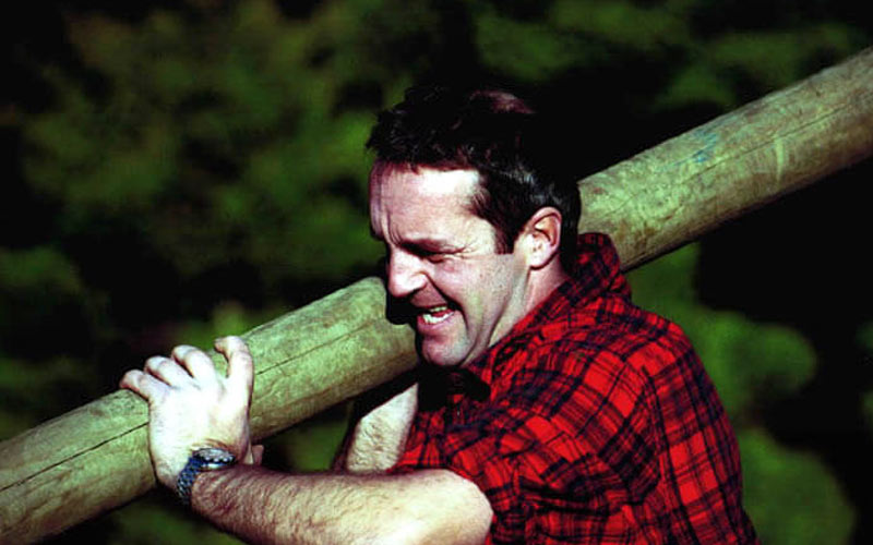 A man carrying a log