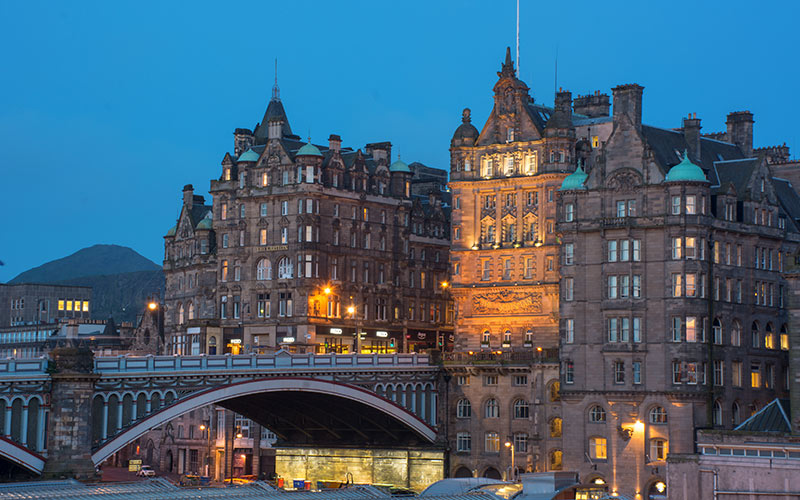 A grand hotel in Edinburgh at dusk