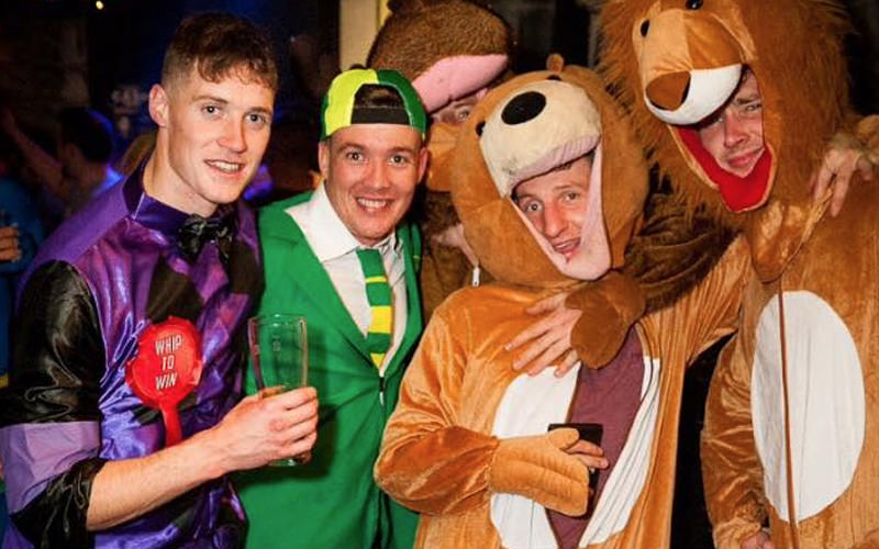 Five men in fancy dress, in a club in Galway