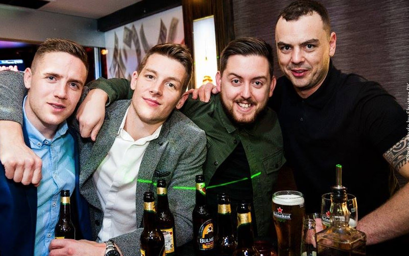 Four men with beers in a pub