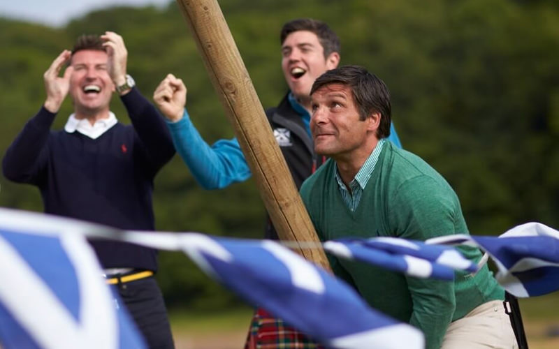 Three men playing the highland games