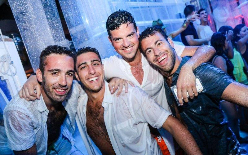Four men in wet T-shirts on their stag do