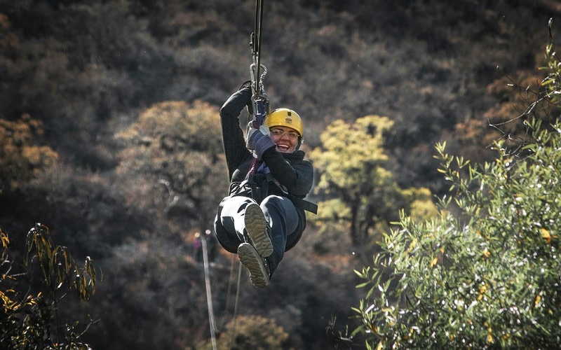 A girl on a zipwire travelling through the trees
