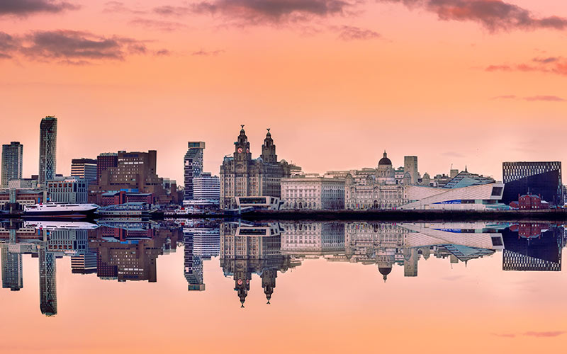 Some buildings reflecting in the water in Liverpool