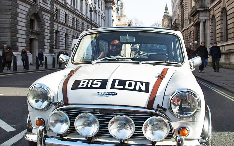 A Mini Cooper being driven through London city centre